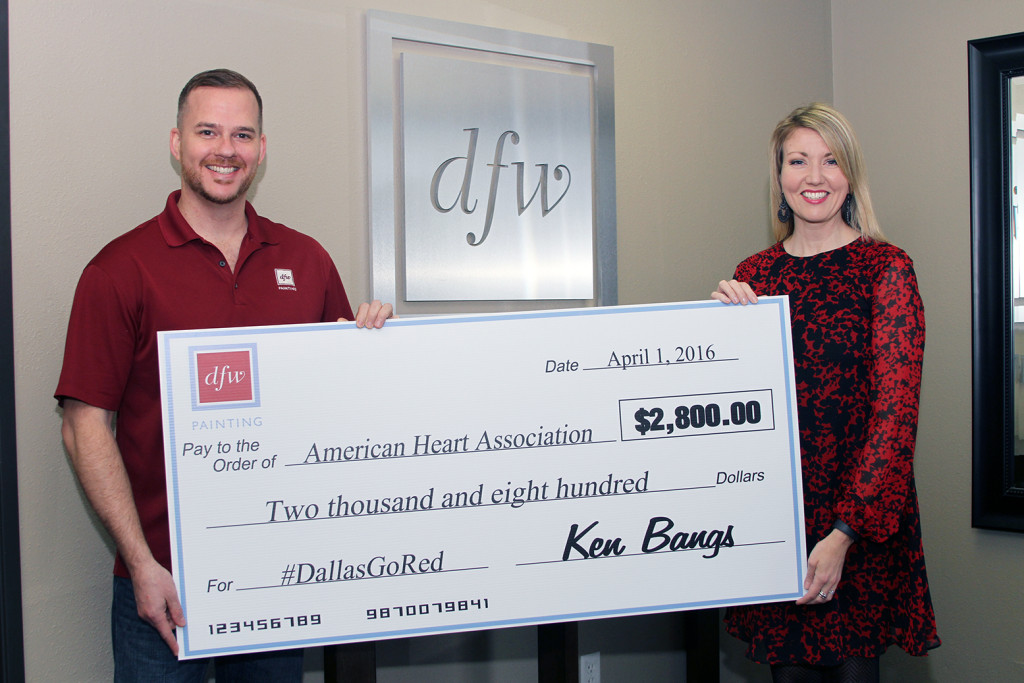 Owner, Ken Bangs presents check to Rachael Lewis, Senior Corporate Market Director for the American Heart Association