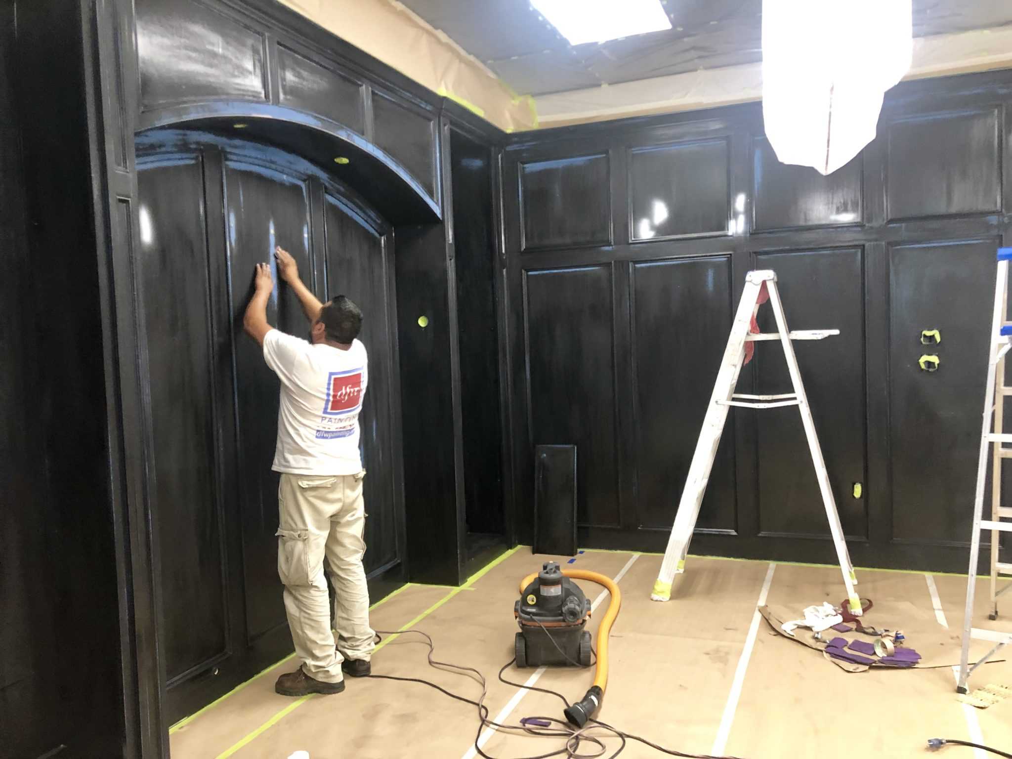DFW Painting professional painter preparing a wall for lacquer paint.